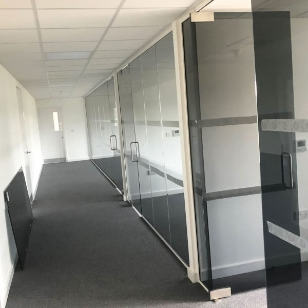 single glazed partitions with manifestations