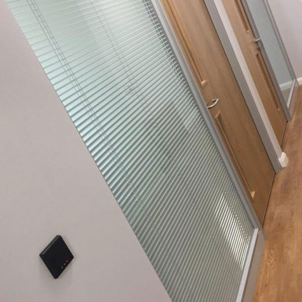 integrated blinds in glass office